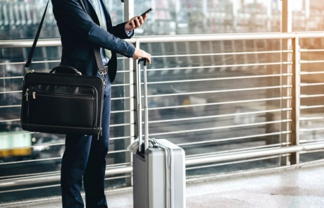 an-asian-businessman-is-using-a-smartphone-to-get-in-business-while-waiting-for-a-trip-in-the-airport.-image-min